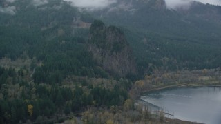 AX154_026 - 6K stock footage aerial video flying by Beacon Rock in Columbia River Gorge, Skamania County, Washington