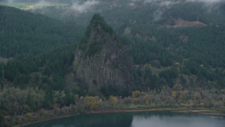 AX154_027 - 6K stock footage aerial video flying by Beacon Rock in the Columbia River Gorge, Skamania County, Washington