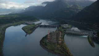 AX154_030 - 6K stock footage aerial video orbiting Bonneville Dam in the Columbia River Gorge