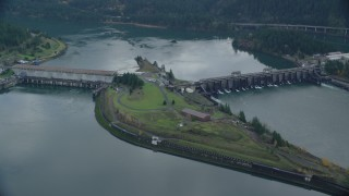 AX154_031 - 6K stock footage aerial video orbiting of Bonneville Dam in Columbia River Gorge