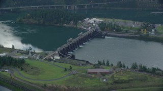 AX154_032 - 6K stock footage aerial video orbiting the Bonneville Dam in Columbia River Gorge