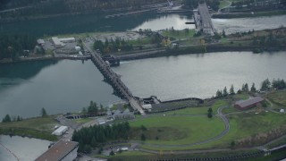 AX154_033 - 6K stock footage aerial video orbiting the Bonneville Dam in Columbia River Gorge