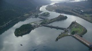 AX154_034 - 6K stock footage aerial video orbiting the Bonneville Dam in the Columbia River Gorge