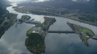 AX154_035 - 6K stock footage aerial video orbiting Bonneville Dam in the Columbia River Gorge