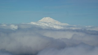 AX154_069 - 6K stock footage aerial video of Mt Adams' snowy summit in the distance and low cloud cover, Mount Adams, Cascade Range, Oregon