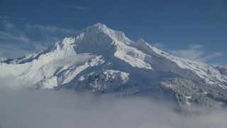 AX154_079 - 6K stock footage aerial video of Mount Hood covered in snow, Mount Hood, Cascade Range, Oregon