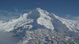 AX154_080 - 6K stock footage aerial video of snow-covered slopes of Mount Hood, Cascade Range, Oregon