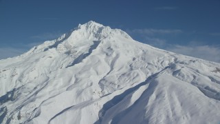AX154_083 - 6K stock footage aerial video of Mount Hood slops covered in snow, Mount Hood, Cascade Range, Oregon