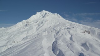 AX154_084 - 6K stock footage aerial video of Mount Hood covered in snow, Mount Hood, Cascade Range, Oregon