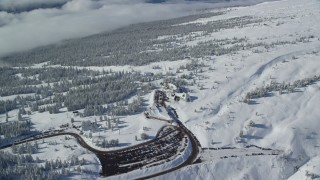 AX154_092 - 6K stock footage aerial video orbiting Timberline Lodge and snowy forest on Mount Hood, Cascade Range, Oregon