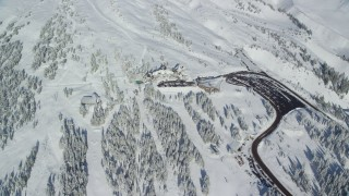 AX154_095 - 6K stock footage aerial video of Timberline Lodge on the snowy slopes of Mount Hood, Cascade Range, Oregon