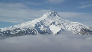 AX154_110 - 6K stock footage aerial video of low clouds and Mount Hood, Cascade Range, Oregon