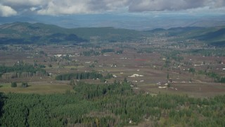 AX154_136 - 6K stock footage aerial video approaching farms and farmland in Parkdale, Oregon