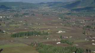 AX154_137 - 6K stock footage aerial video of farms and fields in Parkdale, Oregon