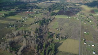 AX154_141 - 6K stock footage aerial video flying over farms in Parkdale, Oregon