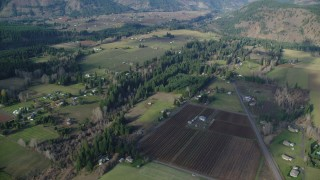 AX154_142 - 6K stock footage aerial video flying over rural farms in Parkdale, Oregon