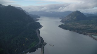 AX154_158 - 6K stock footage aerial video flying over the Columbia River to approach I-84 in the Columbia River Gorge