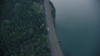 AX154_159 - 6K stock footage aerial video of a bird's eye view of light traffic on Interstate 84 in Columbia River Gorge, Hood River County, Oregon