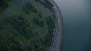 AX154_160 - 6K stock footage aerial video looking down on light traffic traveling on Interstate 84 through Columbia River Gorge, Hood River County, Oregon