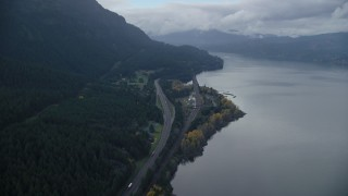 AX154_161 - 6K stock footage aerial video flying over light traffic on Interstate 84 in Columbia River Gorge