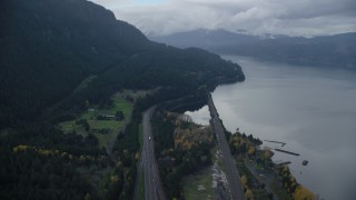 AX154_162 - 6K stock footage aerial video following Interstate 84 with light traffic through the Columbia River Gorge