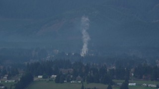 AX154_164 - 6K stock footage aerial video of smoke rising from a lumber mill in Carson, Washington