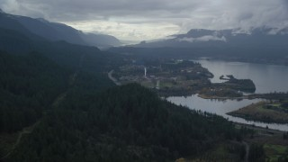 AX154_165 - 6K stock footage aerial video approaching I-84 and the small town of Cascade Locks, Oregon in Columbia River Gorge