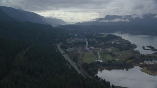 AX154_166 - 6K stock footage aerial video flying over I-84 and forest by the small town of Cascade Locks, Oregon in Columbia River Gorge