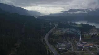AX154_167 - 6K stock footage aerial video flying over I-84 and forest beside Cascade Locks, Oregon in Columbia River Gorge