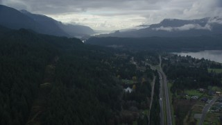 AX154_168 - 6K stock footage aerial video flying over forest by Interstate 84, Cascade Locks, Oregon in Columbia River Gorge