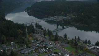 AX154_172 - 6K stock footage aerial video flying over small town RV park and hotel to approach the Bridge of the Gods, Cascade Locks, Oregon in Columbia River Gorge
