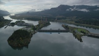 AX154_177 - 6K stock footage aerial video flying by one of the Bonneville Dam structures in the Columbia River Gorge