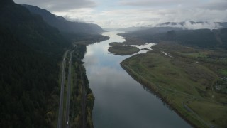 AX154_179 - 6K stock footage aerial video following Columbia River and I-84 highway toward islands in Columbia River Gorge