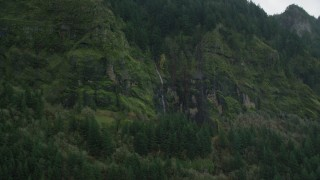 AX154_187 - 6K stock footage aerial video of a waterfall on steep green cliffs on the Oregon side of Columbia River Gorge