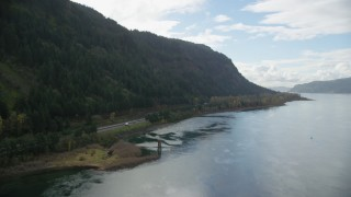AX154_188 - 6K stock footage aerial video approaching the I-84 highway in the Columbia River Gorge, on the Oregon side