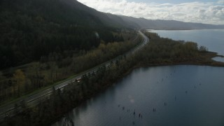 AX154_191 - 6K stock footage aerial video flying by the I-84 highway with light traffic on the Oregon side of Columbia River Gorge