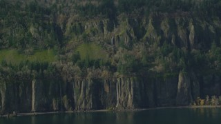 AX154_194 - 6K stock footage aerial video of four waterfalls on steep green cliffs on the Washington side of Columbia River Gorge
