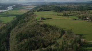 AX154_198 - 6K stock footage aerial video of an isolated home and green fields, Washougal, Washington