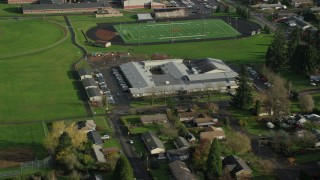 AX154_205 - 6K stock footage aerial video orbiting Gause Elementary and the Washougal High School football and baseball fields in Washougal, Washington