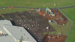 AX154_206 - 6K stock footage aerial video orbiting the Gause Elementary playground in Washougal, Washington