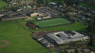 AX154_209 - 6K stock footage aerial video flying away from Gause Elementary, Washougal High School, and sports fields in Washougal, Washington