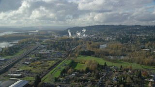 AX154_210 - 6K stock footage aerial video approaching Washougal River and the Georgia Pacific Paper Mill in Camas, Washington