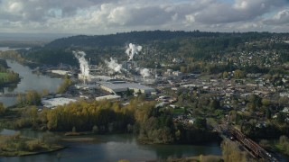 AX154_212 - 6K stock footage aerial video approaching the Georgia Pacific Paper Mill in Camas, Washington