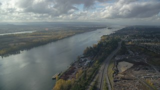 AX154_215 - 6K stock footage aerial video following Highway 14 and the Columbia River toward the I-205 Bridge in Vancouver, Washington