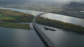 AX154_219 - 6K stock footage aerial video of I-205 Bridge spanning the Columbia River, Vancouver, Washington