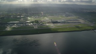 AX154_220 - 6K stock footage aerial video of godrays shining down on the Portland International Airport, approach from the Columbia River