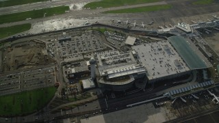 AX154_222 - 6K stock footage aerial video of a bird's eye view of the control tower and parking structure at the Portland International Airport, Oregon
