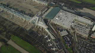 AX154_223 - 6K stock footage aerial video flying away from Portland International Airport, Oregon