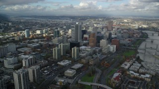 AX154_234 - 6K stock footage aerial video orbiting skyscrapers in Downtown Portland, Oregon, reveal Riverplace Marina by Hawthorne Bridge