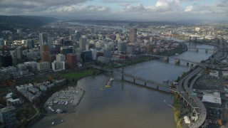 AX154_235 - 6K stock footage aerial video orbiting skyscrapers in Downtown Portland, Oregon, seen from across the Willamette River